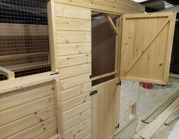 large rabbit shed with internal mesh to windows and full door